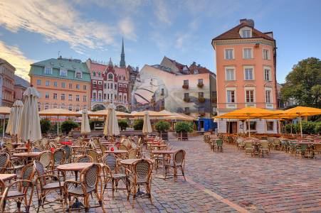 Cobbled City Square With Outdoor Restaurants Among Colorful Buildings In Riga